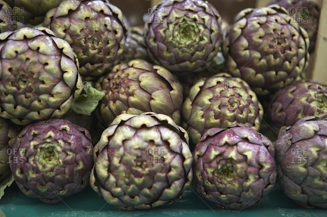 Fresh Stacked Artichokes at the Market