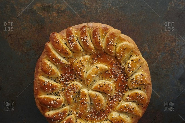 Round Loaf of Decorative Bread with Sesame Seeds