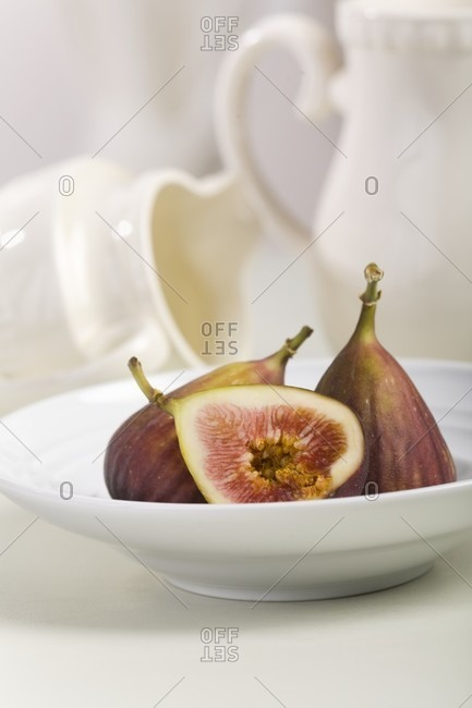 Figs; Half and Whole in a White Bowl; Pitchers