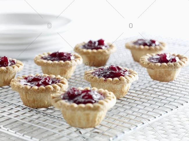 Cranberry tartlets on a wire rack