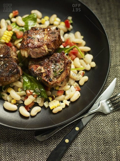 Lamb chops on a bean and corn salad