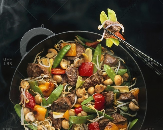 Chinese stir-fried beef in a wok
