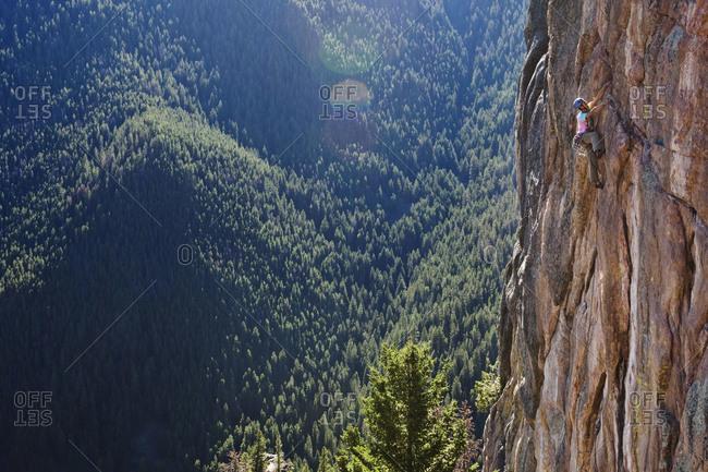 A athletic man rock climbing in Montana.