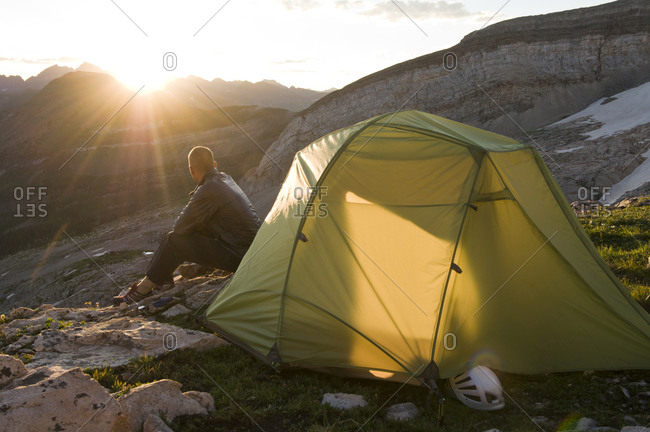 A man enjoying a sunrise while camping in the White River National Forest, Crystal, Colorado.