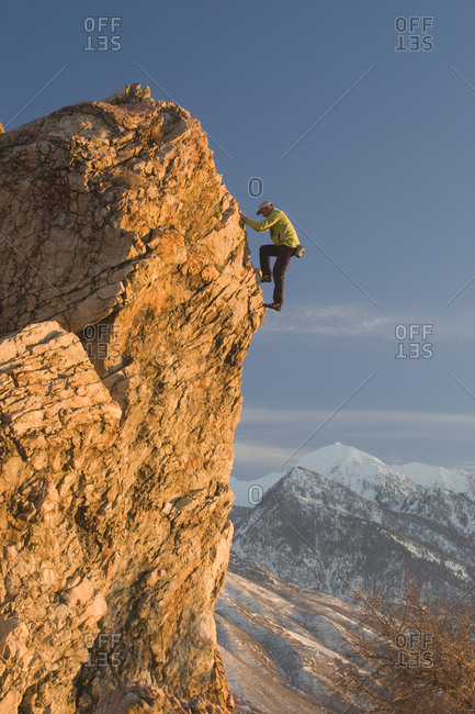 A man rock climbing up a steep climb, Salt Lake City, Utah.