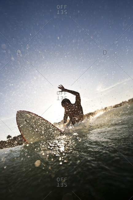 Man surfing in southern California. San Diego, California surfing.