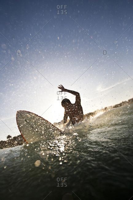 Man surfing in southern California. San Diego, California surfing.