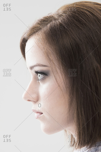 Profile of young woman, studio shot