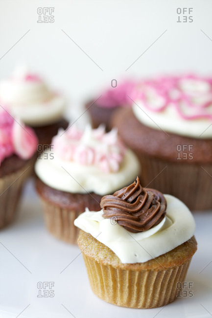 Homemade vanilla and chocolate cupcakes with butter cream frosting