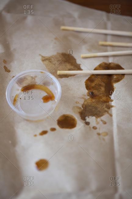 Thai take out mess with chopsticks