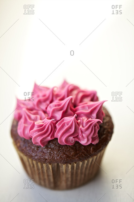 Homemade chocolate cupcake with butter cream frosting