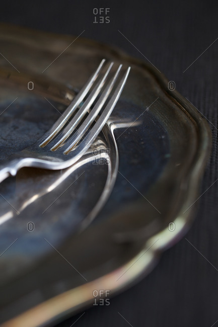 Silver fork on a silver tray