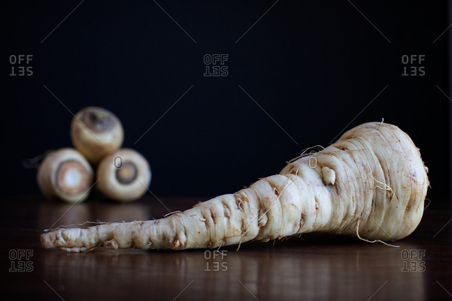 Parsnips on wood black background