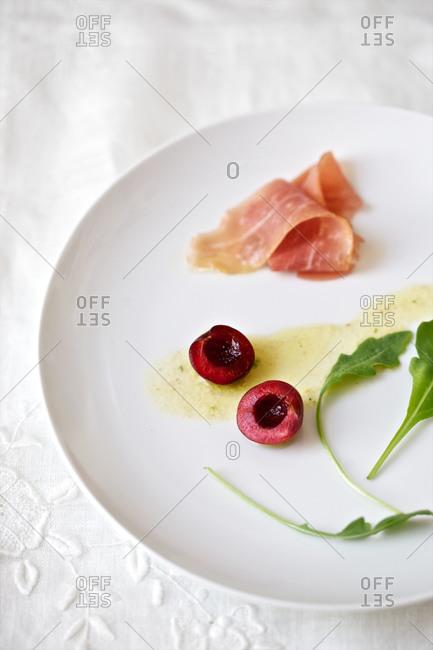 Prosciutto, cherry, arugula, mustard dressing