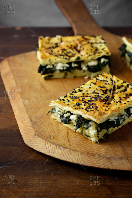 Spinach borek served on wooden cutting board