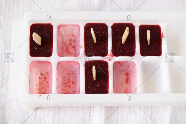 Mixed berry ice pops in ice cube tray