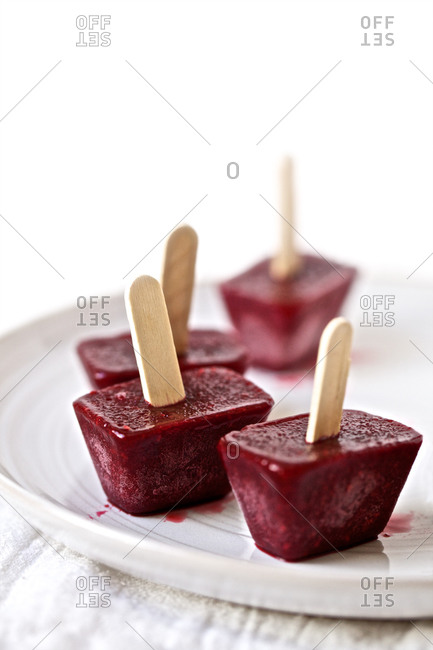 Mixed berry ice pops on plate