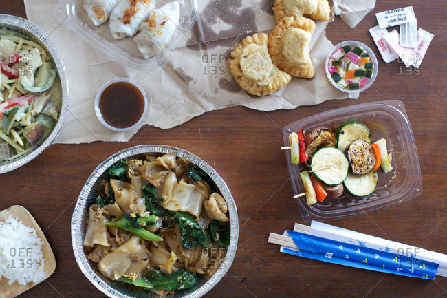 Leftovers and take out mess on the table