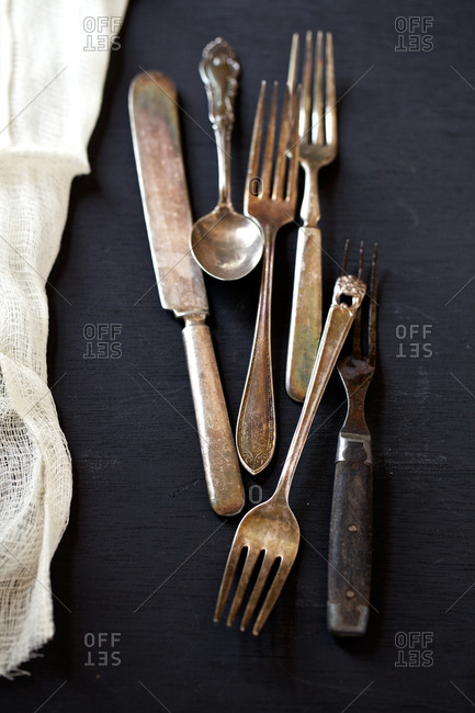 Antique cutlery stacked on a table