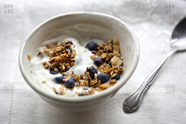 Yogurt with blueberries and granola served for breakfast