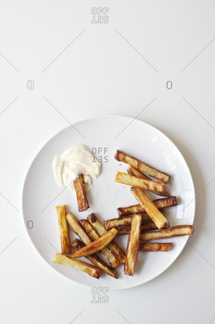 Fries and mayonnaise dip served on a plate