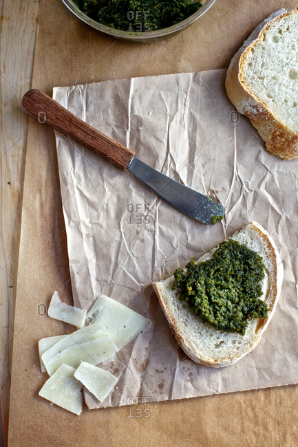 Toast served with home made pesto and romano cheese