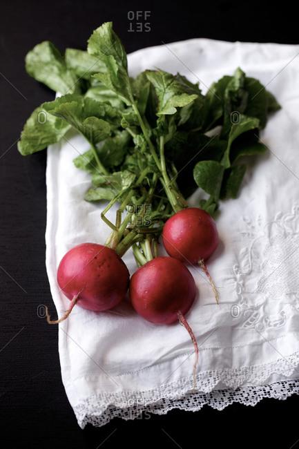Fresh radish prepared on dish cloth