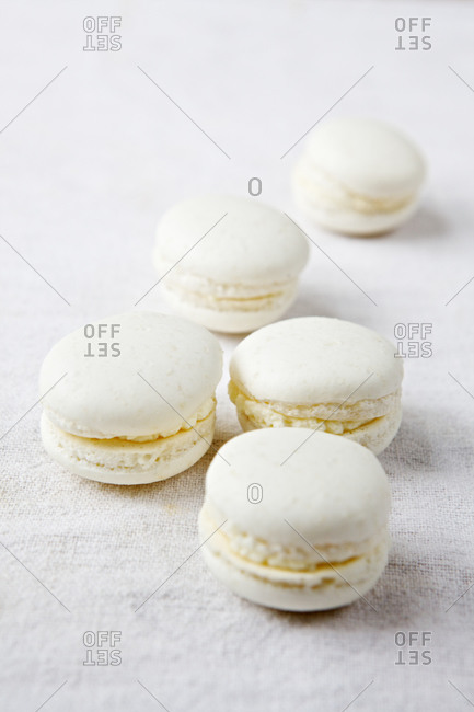 White macaroons with almond butter filling on fabric
