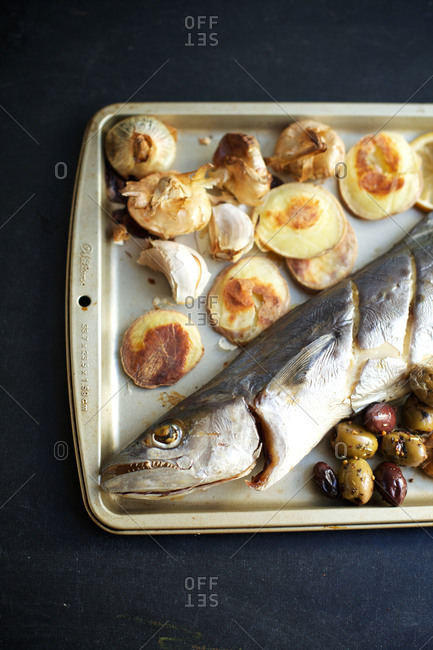 Flavorful grilled mackerel served with roasted potatoes and olives