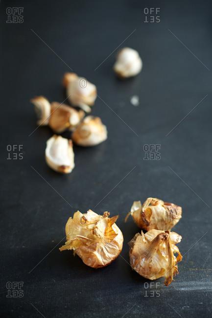Close up of garlic on chalk board