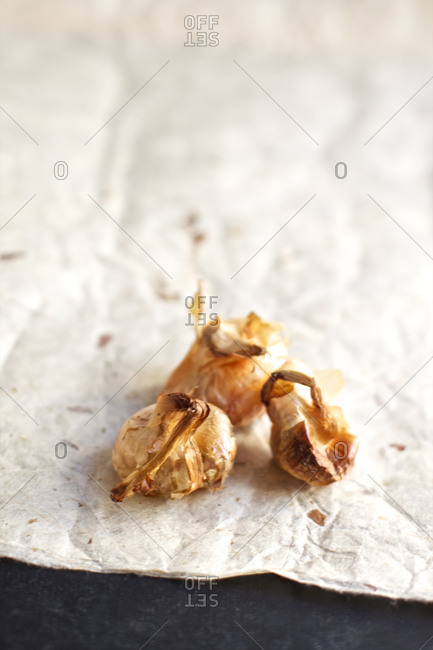 Close up of garlic on textured paper