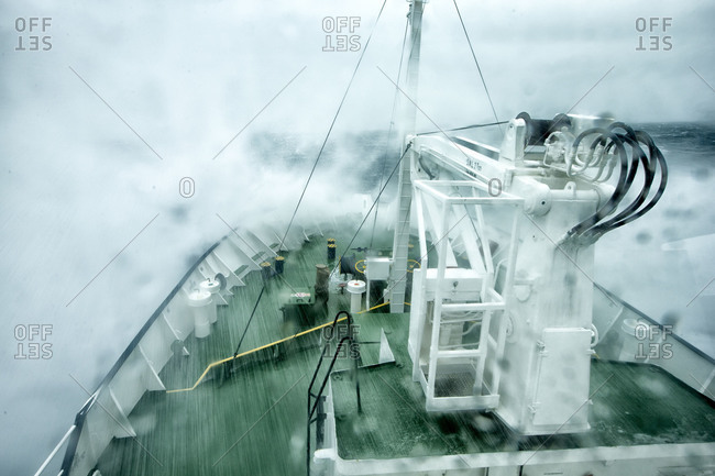 Ship crashing into the waves on the open arctic sea