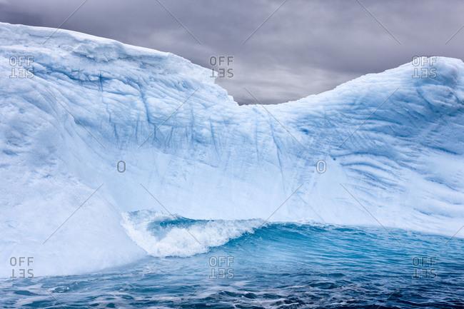 Massive iceberg floating in ocean water in Antarctica