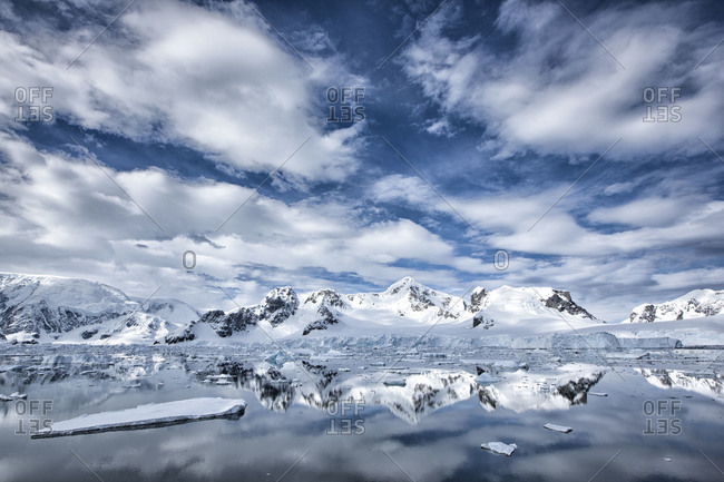 Antarctic coast line of mountains covered in snow and ice