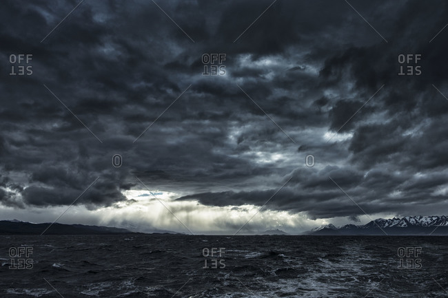 Stormy sky over the ocean and coast of Antarctica