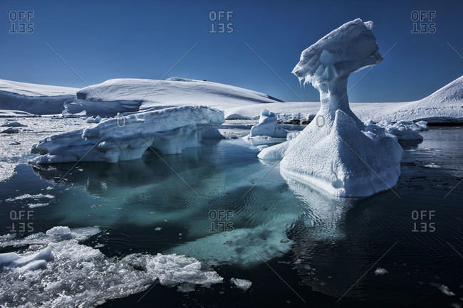 Iceberg formations floating offshore of the ice sheet of Antarctica