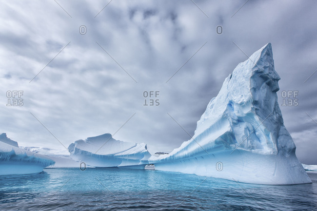 Massive iceberg formations floating offshore of the ice sheet of Antarctica