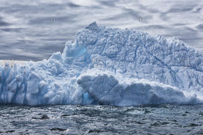 Iceberg floating in ocean water in Antarctica