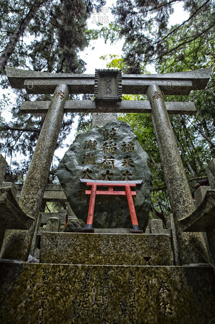 Stone and wooden Shinto gates in Kyoto Japan