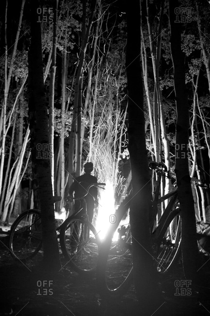 Mountain bikers at a bonfire