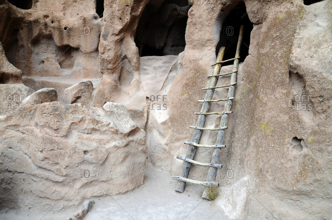 A wooden ladder leads to the famous cliff dwellings in Bandelier National Monument, NM.