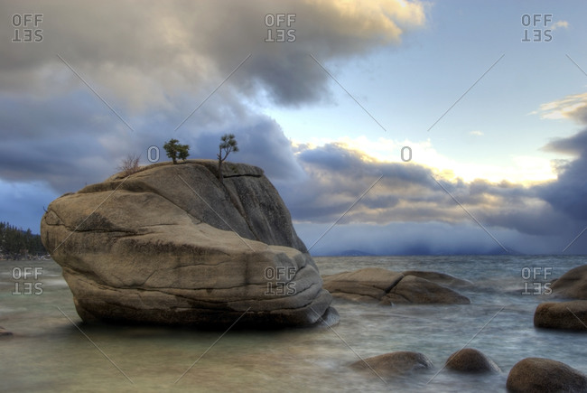 Dramatic clouds and light frame Bonsai Rock on the east shore of Lake Tahoe, NV.