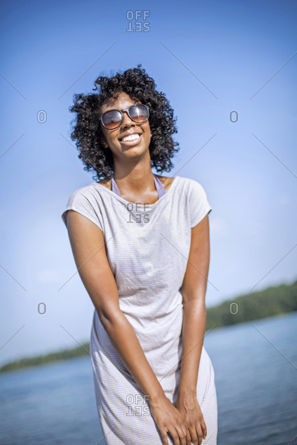 A young woman smiles while wearing sunglasses at Lake Wedowee.