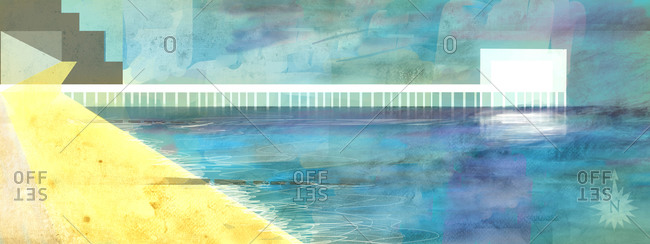 Landscape of white pier over bright blue ocean and yellow beach