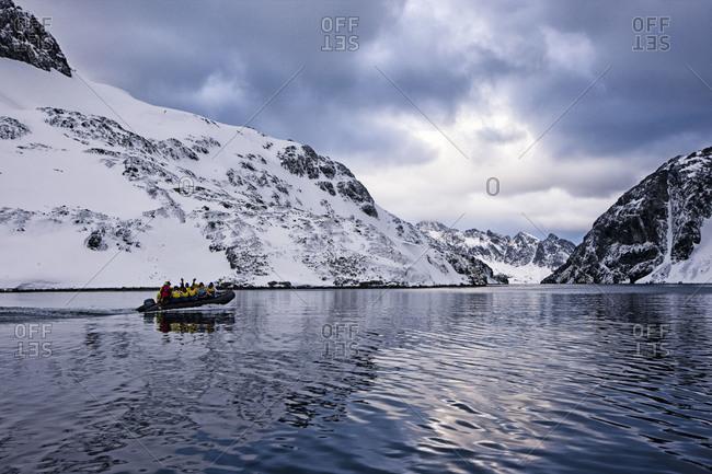 Boat of people near Drygalski Fjord, South Georgia