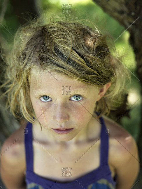 young girl looks at camera