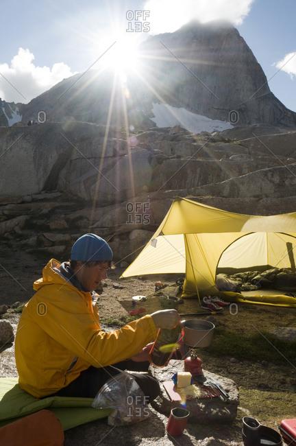 Man preparing food at alpine campground, Bugaboo Provincial Park, Radium, British Columbia, Canada