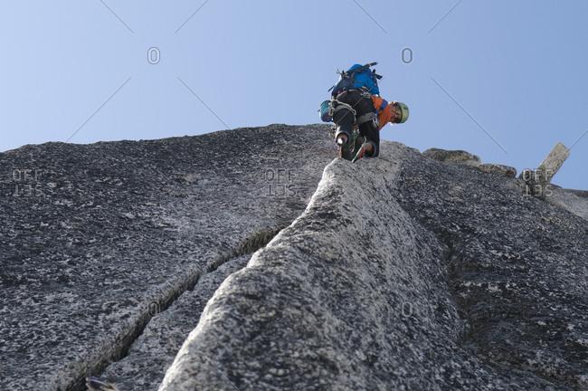 Man rock climbing granite crack, Bugaboo Provincial Park, Radium, British Columbia, Canada