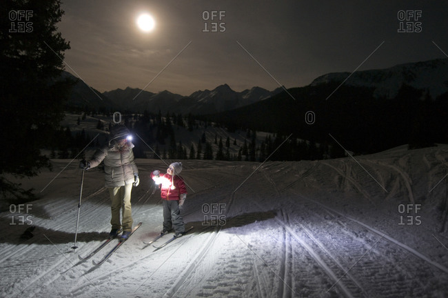Mother and daughter on a nighttime cross country ski on Molas Pass, Silverton, Colorado
