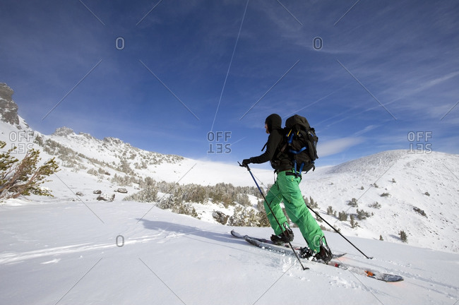 A snowboarder on a splitboard skins up Red Lake Peak near Lake Tahoe, CA.